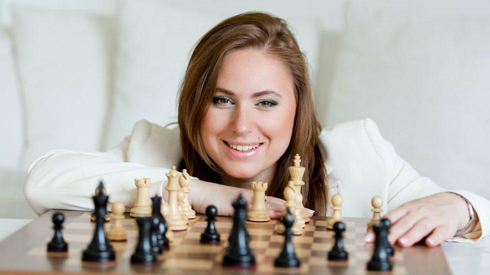 Polgár Judit behind a chess table