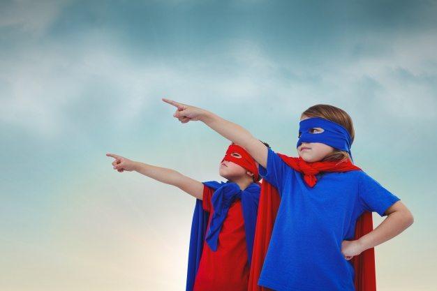 Kids dressed as superheroes