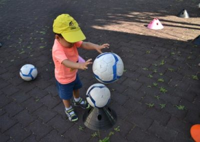 Little boy is playing with a ball in the nursery school