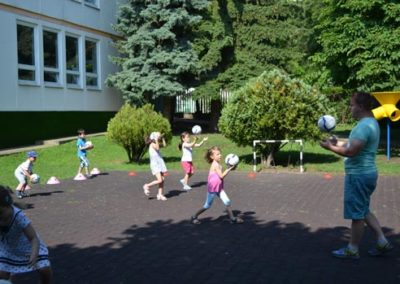 Kids are playing ball games in the nursery school